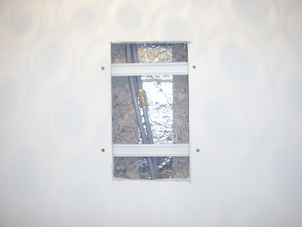 Emergency Plumber East Kilbride - nailed through pipe has been repaired and support brackets added for the reinstatement of the plasterboard. A A MacMillan Plumbers