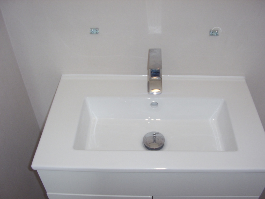 New white ceramic basin cabinet unit fitted with single lever mixer tap and pop up waste - A A MacMillan Plumbers of East KIlbride