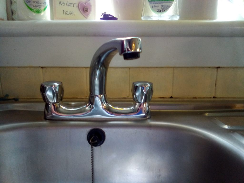 Shiny new chrome plated deck mixer taps that has just been supplied and fitted by A A MacMillan Plumbers of East Kilbride